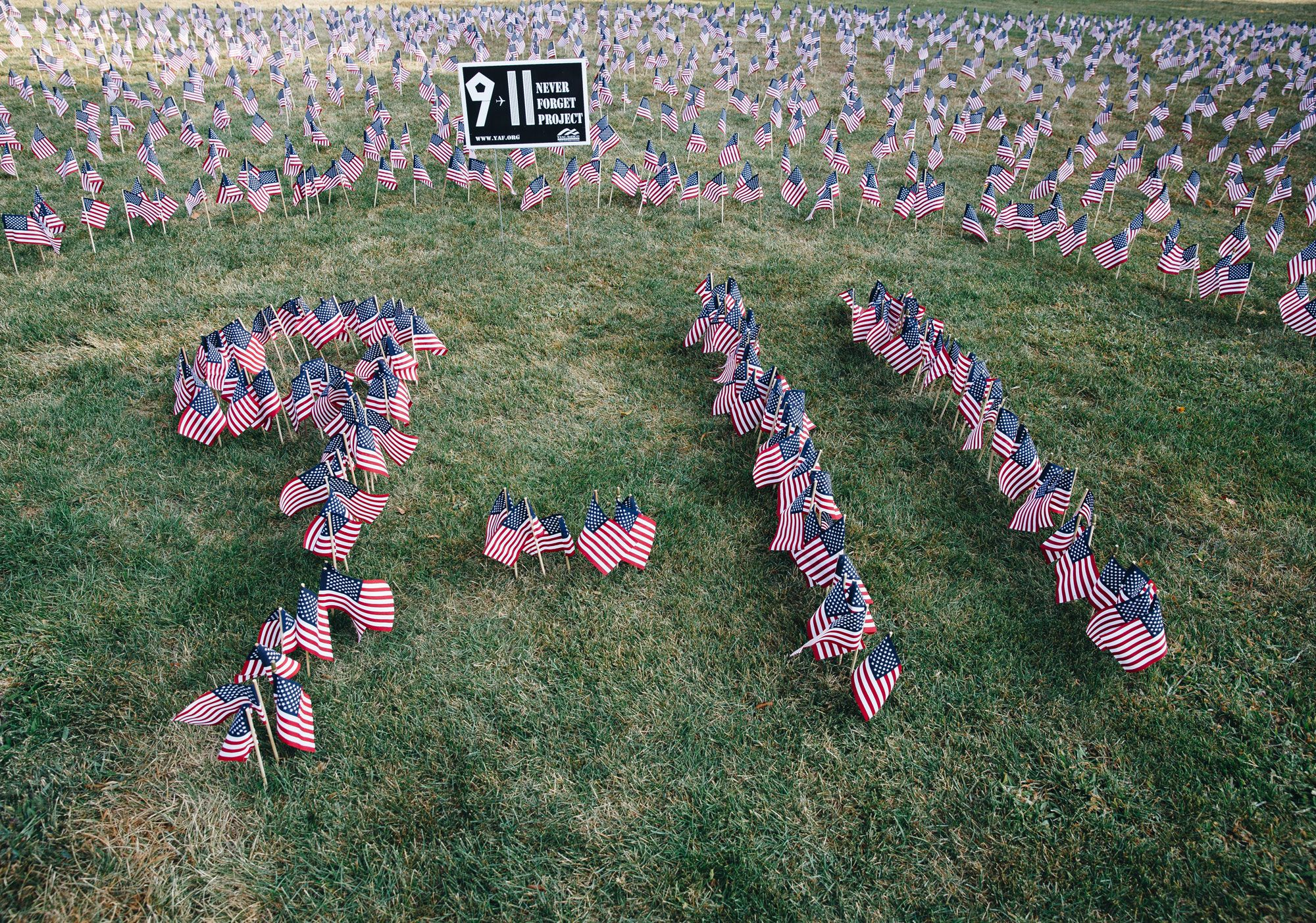 """""""May the God of hope fill you with all joy and peace as you trust in him, so that you may overflow with hope by the power of the Holy Spirit."""" --Romans 15:13. In 2016 the Wheaton College Young Americans for Freedom put together this moving display of flags representing each of the 2,996 precious lives that were lost on September 11, 2001."""