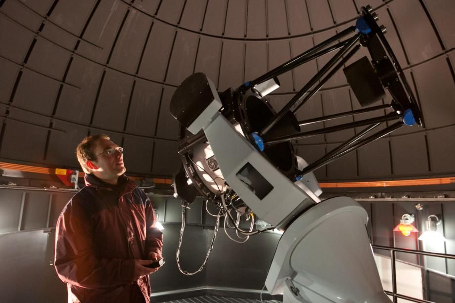 AJ Poelarends using 24-inch Planewave telescope in Wheaton College Observatory